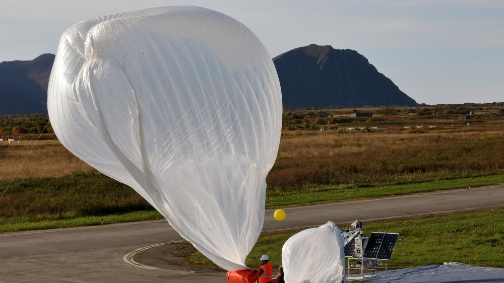 An electronics and engineering team from Raven Aerostar launches a high altitude balloon from Andoya Air Station to sense a simulated target in the Norwegian Sea during the Thunder Cloud live-fire exercise in Andoya, Norway, Sept. 15, 2021. Three high altitude balloons were launched into the stratosphere and relayed data to project coordinates for sensor to shooter fires.