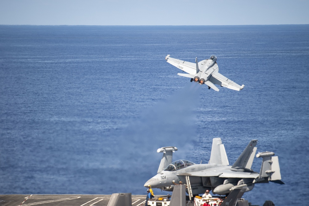 """An EA-18G Growler, assigned to the """"Gauntlets"""" of Electronic Attack Squadron (VAQ) 136, launches off the flight deck of Nimitz-class aircraft carrier USS Carl Vinson (CVN 70)."""