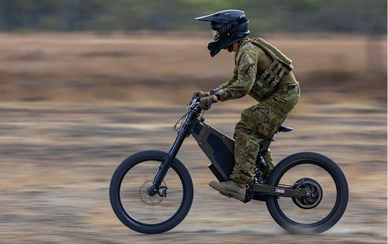 Trooper Timothy Palmer from the 2nd/14th Light Horse Regiment (Queensland Mounted Infantry) training on the Australian Army Stealth Reconnaissance E-Bike at Townsville Field Training Area, Queensland.