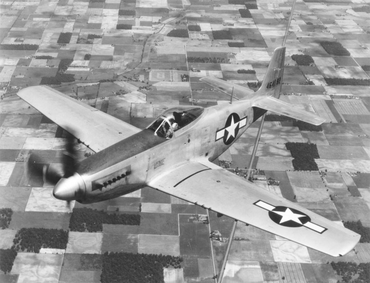 A P-51 Mustang in Flight Over Rural America