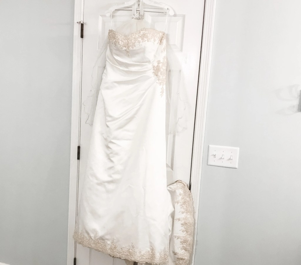 wedding dress hanging on anniversary