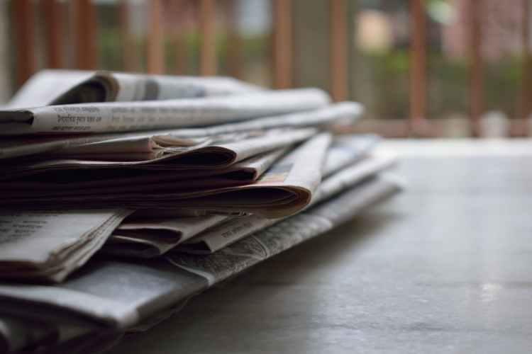 selective focus photography of magazines
