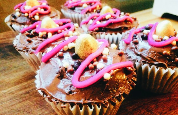 Leftover Easter egg cupcakes topped with a chocolate orange icing