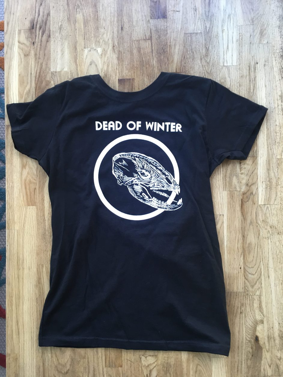 Photograph of t-shirt. Black with white skull an circle, and text saying Dead of Winter