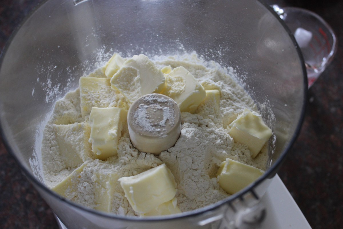 chunks of butter, placed on top of the dry ingredients for the pie dough