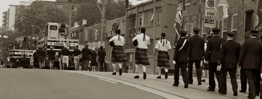 Climbing Dufferin St near Queen, first The International Union of Operating Engineers Local 793, followed by bagpipers leading a group of Toronto Fire Services members (Toronto Labour Day Parade, September 2, 2013)