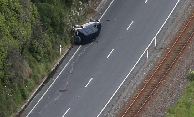This aerial photo taken and received on November 14, 2016 shows a car on its side near Kaikoura following an earthquake on the South Island's east coast. A powerful 7.8-magnitude earthquake killed two people and caused massive infrastructure damage in New Zealand, but officials said on November 14 they were optimistic the death toll would not rise further. The jolt, one of the most powerful ever recorded in the quake-prone South Pacific nation, hit just after midnight near the South Island coastal town of Kaikoura. / AFP PHOTO / POOL / MARK MITCHELLMARK MITCHELL/AFP/Getty Images