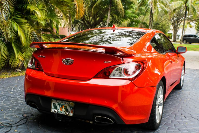 2010 Hyundai Genesis Coupe with a rear spoiler installed.