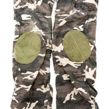"With the white background and using flash, they might seem out of place. But in ""real life"" they don't look that odd, and could possibly look like they are for construction knee pads or something of the sort. A camo velcro patch could also be put on top if desired."