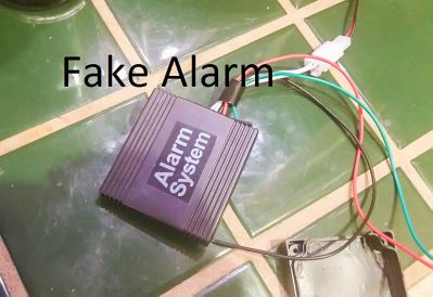 Is the decal on the fake dummy alarm a bit much?