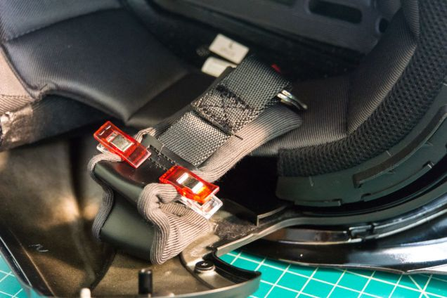 Peel back the strap pad to reveal the original stitching pattern of the D-Ring buckle. We will try to imitate it.