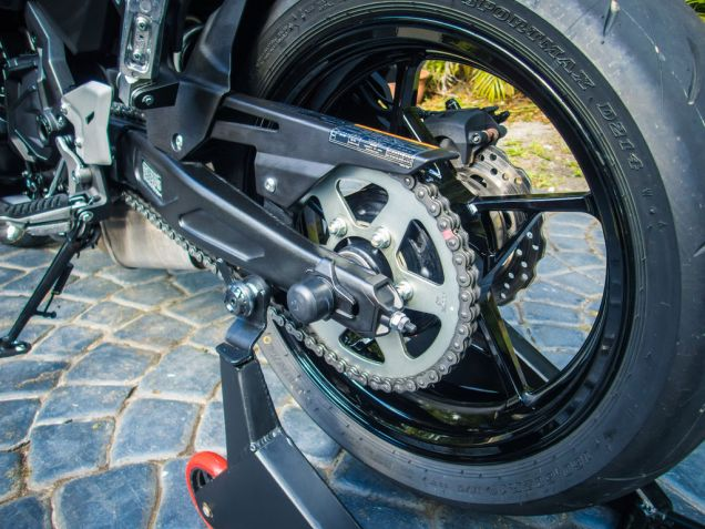 See how these spools have a spacer separating them from the swingarm, and a deep groove? That will keep the stand's yoke away from scratching the swingarm, as well as much more securely in place.