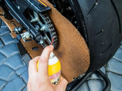 Pro-Tip: As you lube the chain, move the wheel forward so the lube drips from the top of the link to the bottom, lubricating it entirely.