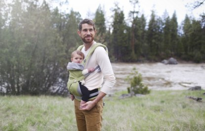 ergobaby carrier for dad. check out fatherly's best baby carriers! get dad helping with housework