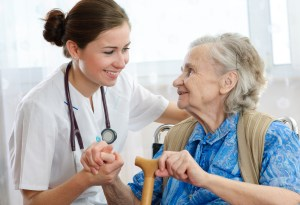 nursing home photo with elderly woman and nurse