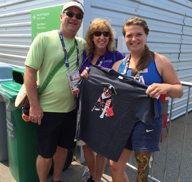 Mark and Nancy give USA Paralympic Kayaker Kelly Allen a Keating Pirate Shirt after her race!