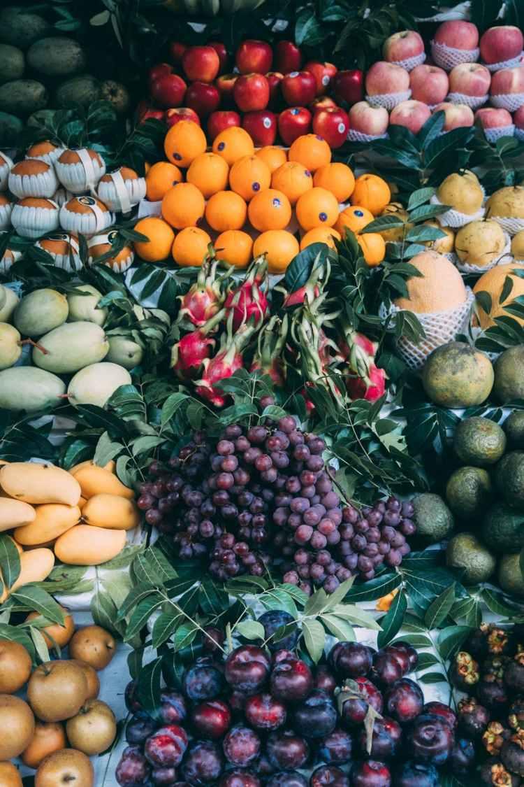 assorted fruits on black plastic basket