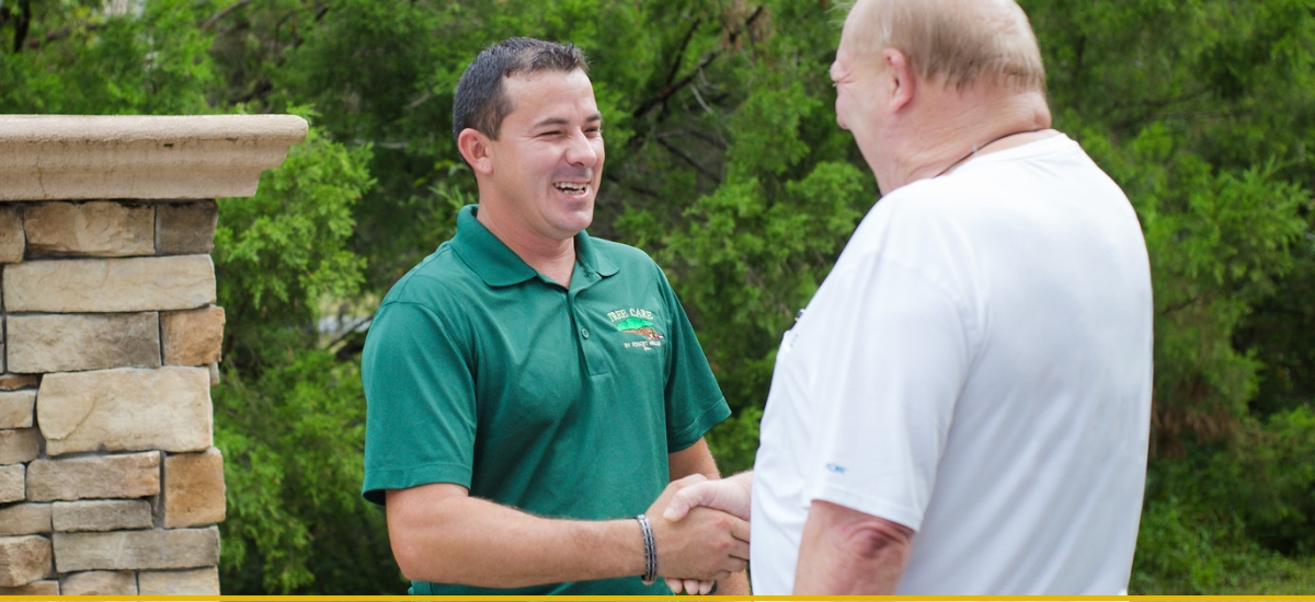 Foreman, Jeff, shakes hands with happy customer after tree service