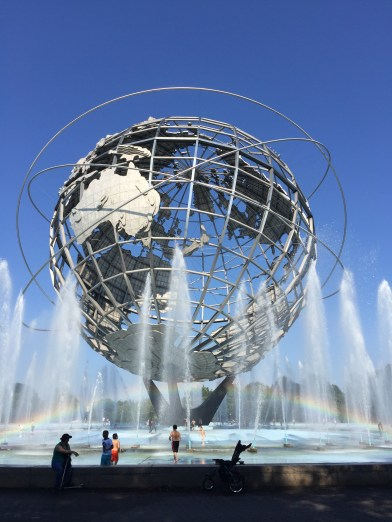 Unisphere in Flushing Meadows Corona Park with a rainbow