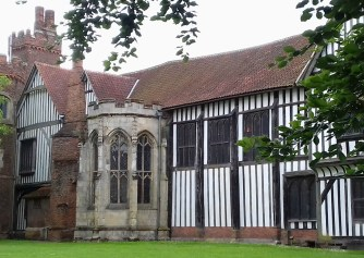 Outside of the Hall with the original medieval brick tower in the background