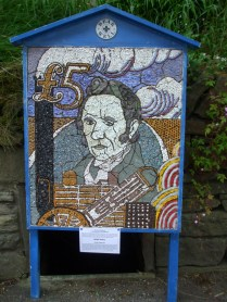 George Stephenson, inventor of the famous Rocket steam locomotive. The well can be seen at the bottom of the well dressing board.