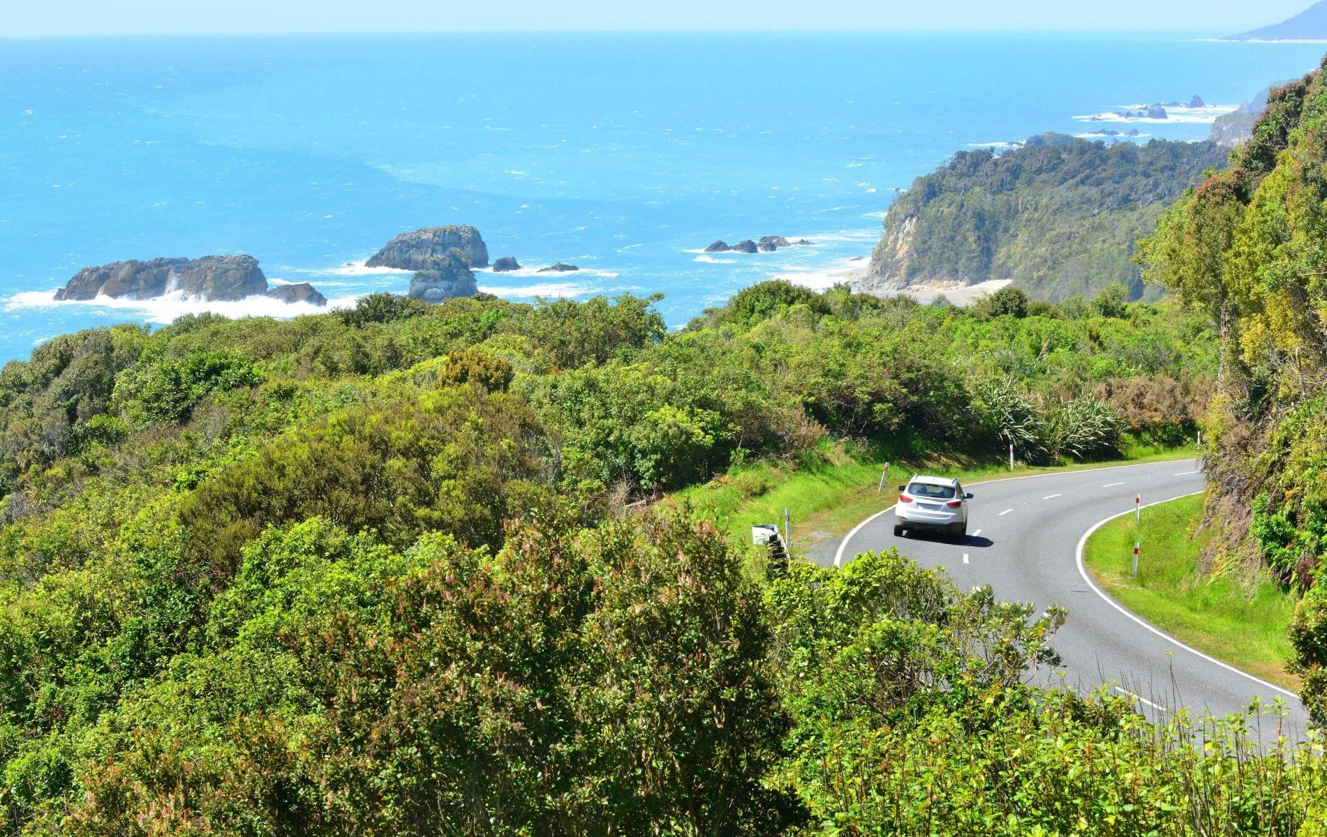 Driving along New Zealand Coast in Rental Car