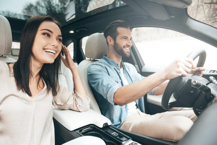 Happy couple in rental car