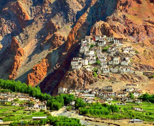 Beautiful scenic view - ancient Stongde Buddhist Monastery (Gompa) and traditional Tibet village against the background of barren mountain wall in Suru valley, Ladakh, Himalaya, Jammu & Kashmir, India
