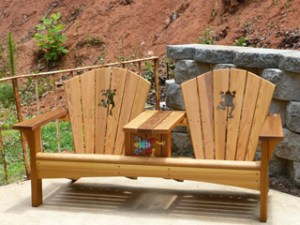 cedar adirondack bench with tree frog