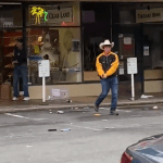 VIDEO: Armed Cigar Store Owners Kick Looters Out Of Shop