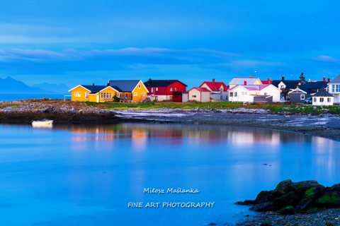 Norwegian rural houses in Andenes, Andoya, Lofoten Islands, Norway. Soft water effect at a blue hour.