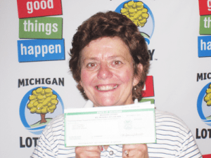 """Judith M. Powell of Essexville claims $1 million from the 09/13/2012 """"Play It Again"""" $1,000,000 Giveaway."""
