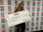 Deanna Wilson of Eastpointe claiming $1 million from  the Mega Millions, December 13, 2013 drawing. (Photo courtesy of the Michigan Lottery.)