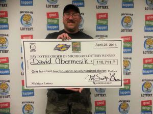 David Obermesik, of Hartford, claiming the top prize of $110,711  from the Michigan Lottery's Cash For Life $1 pull tab game. (Photo courtesy of the Michigan Lottery.)
