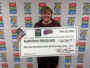 Kathleen McGrath poses for a photo after winning a Cadillac CTS on the Lottery's Cadillac Riches game. McGrath opted for a cash prize of $54,764.