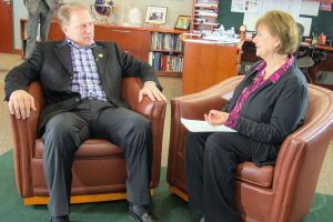 Sheryl Dalman (right) talks with Michigan State University basketball coach Tom Izzo prior to accepting her Excellence in Education Award from the Michigan Lottery.