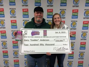 """Gary """"Cudder"""" Anderson poses for a photo with his daughter Cassie after winning $250,000 playing the Michigan Lottery's 50X The Cash instant game."""