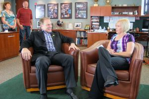 Jan Summey (right) talks with Michigan State University basketball coach Tom Izzo prior to accepting her Excellence in Education Award from the Michigan Lottery.