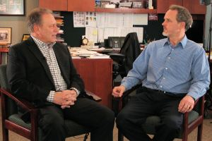 Michael Giles talks with Michigan State University basketball coach, Tom Izzo, prior to accepting his Excellence in Education Award from the Michigan Lottery.