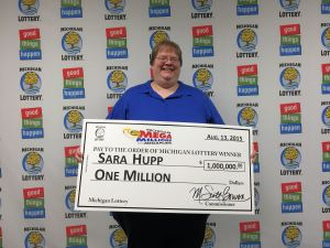 Sara Hupp smiles after collecting her $1 million Mega Millions prize at Lottery headquarters on Thursday.
