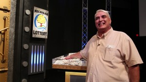 Jeff Ervin smiles after winning $1 million on the Michigan Lottery's $1,000,000 Play It Again game show