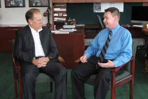 Joseph Rybicki talks with Michigan State University basketball coach, Tom Izzo, after accepting his Excellence in Education award.