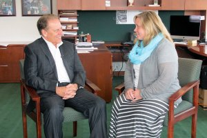 Jessica Couch talks with Michigan State University basketball coach, Tom Izzo, after accepting her Excellence in Education award.