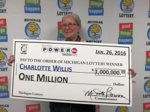 Charlotte May Willis poses for a photo after claiming a $1 million Powerball prize.