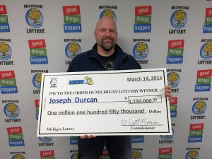 Joseph Durcan smiles after collecting his $1.15 million Lotto 47 jackpot.