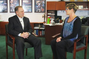 Janet Frye talks with Michigan State University basketball coach, Tom Izzo, after accepting her Excellence in Education award.