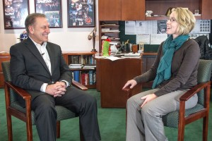 Julie Merchant talks with Michigan State University basketball coach, Tom Izzo, after accepting her Excellence in Education award.
