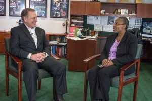 Linda Holmes talks with Michigan State University basketball coach, Tom Izzo, after accepting her Excellence in Education award.