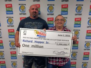 Richard Hopper Sr. (right), and his son, Rich, pose for a photo after collecting Richard's $1 million Mega Millions prize.