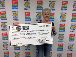 Judy Field-Lampman smiles after collecting her $75,000 prize.